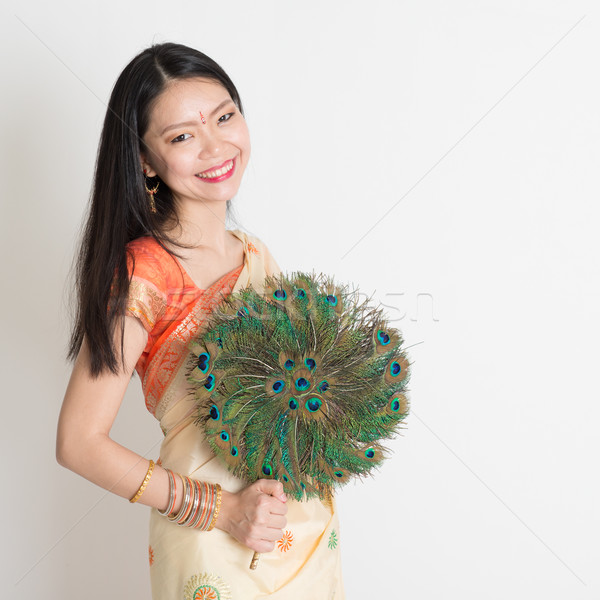 Young female with peacock feather fan in Indian sari dress Stock photo © szefei