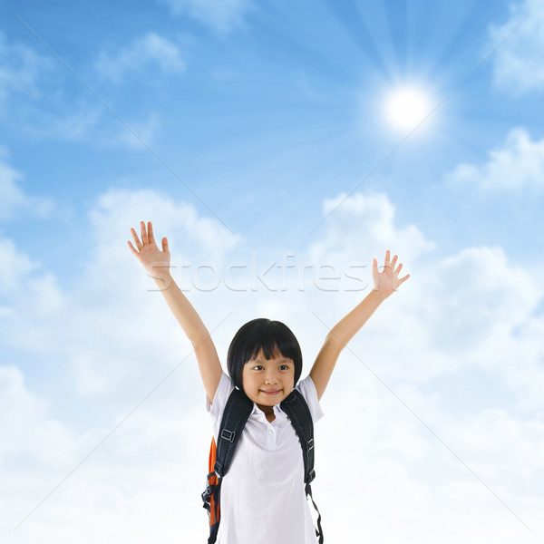 Asian school girl arms up in the air Stock photo © szefei