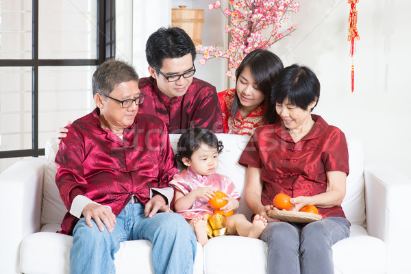 Celebrate Chinese New Year with family Stock photo © szefei