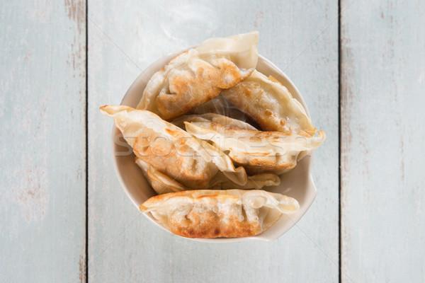 Top view Asian gourmet pan fried dumplings Stock photo © szefei
