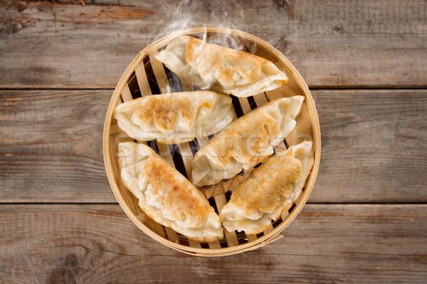 Chinese cuisine pan fried dumplings Stock photo © szefei