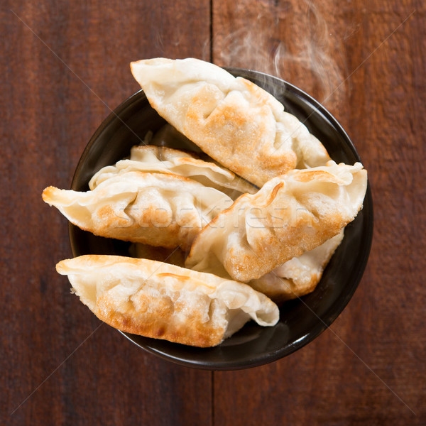 Popular Chinese meal pan fried dumplings Stock photo © szefei