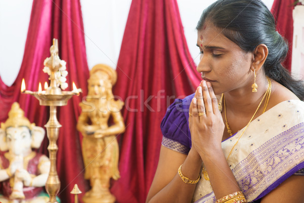 Indian woman praying Stock photo © szefei