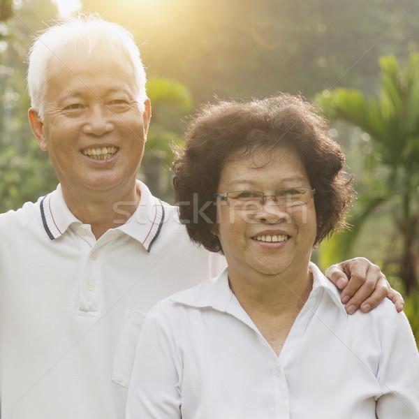 Loving Asian seniors couple outdoors Stock photo © szefei