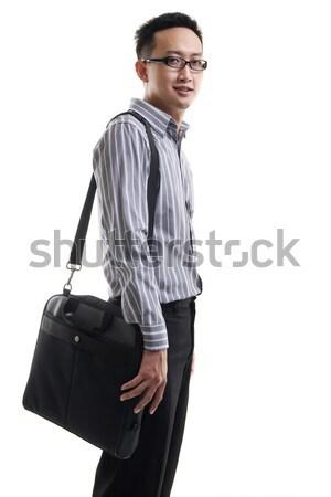 Young Asian man with laptop bag Stock photo © szefei