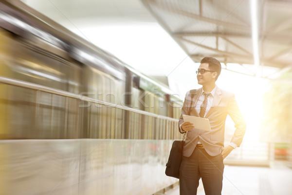 Stock fotó: üzletember · táblagép · vár · vonat · ázsiai · digitális