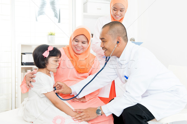 Family doctor and patient.  Stock photo © szefei