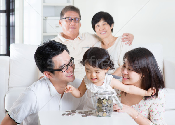 Counting coins Stock photo © szefei