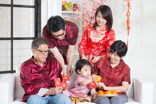 Chinese New Year giving red packets Stock photo © szefei
