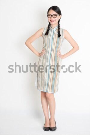 Asian girl greeting pose Stock photo © szefei