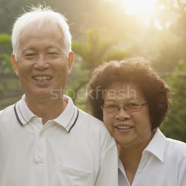 Loving Asian seniors couple Stock photo © szefei