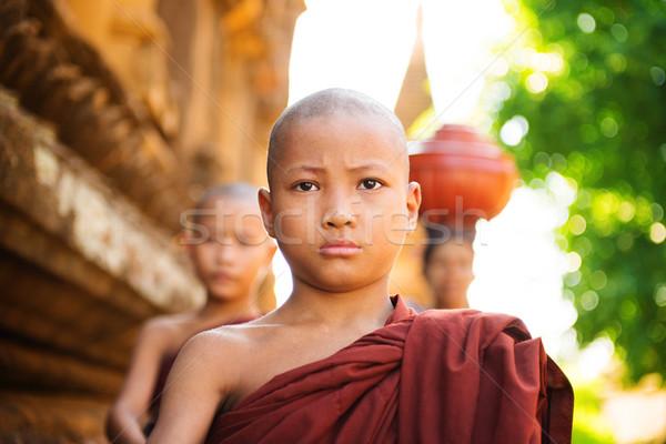 Young Buddhist monks walking morning alms Stock photo © szefei