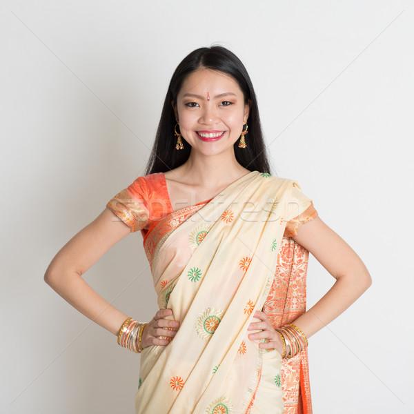 Confident Indian girl in sari smiling  Stock photo © szefei