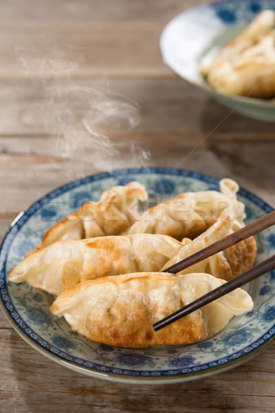 Asian cuisine pan fried dumplings Stock photo © szefei