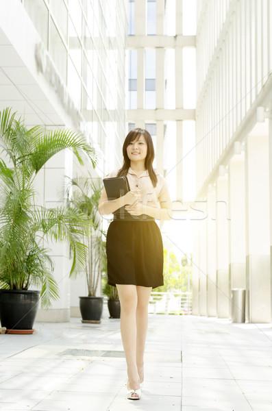 Young Asian woman executive walking Stock photo © szefei