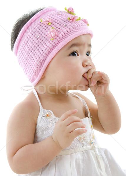 Cute baby girl eating Stock photo © szefei