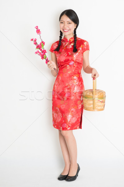 Asian chinese girl holding gift basket and plum blossom Stock photo © szefei