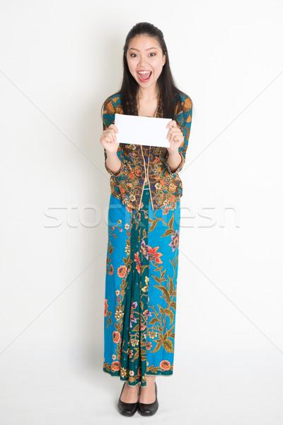Asian female holding an envelope Stock photo © szefei