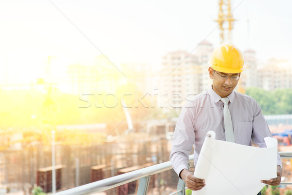 Asian Indian male site contractor engineer inspecting at site Stock photo © szefei