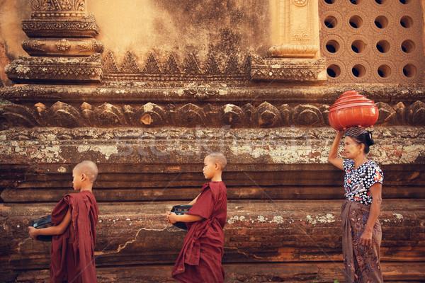Buddhist novice monks collect alms Stock photo © szefei