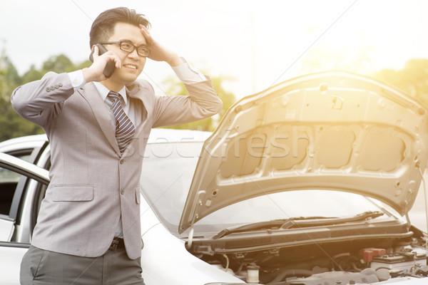 Uomo d'affari auto rotta asian piedi rotto giù Foto d'archivio © szefei