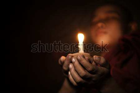 Novice with candlelight Stock photo © szefei
