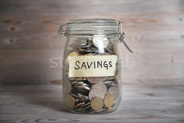 Stock photo: Money jar with savings label.