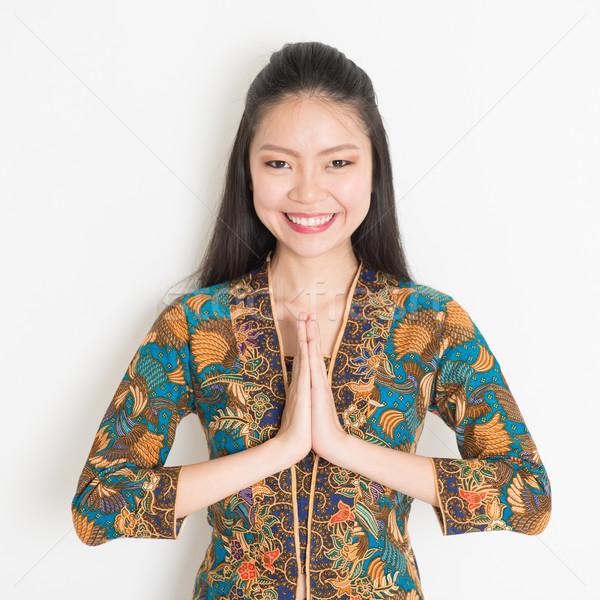 Asian girl greeting Stock photo © szefei
