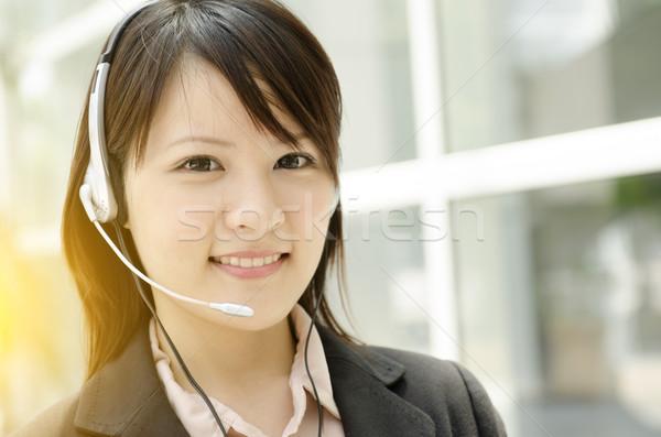 Asian femminile receptionist ritratto giovani auricolare Foto d'archivio © szefei