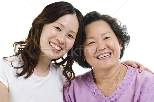 Senior mother and adult daughter headshot Stock photo © szefei
