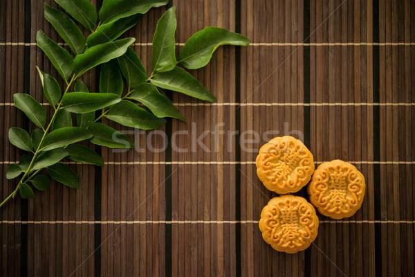 Top down moon cakes on bamboo mat Stock photo © szefei