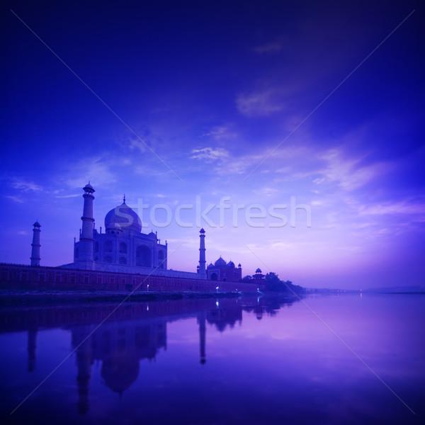 Taj Mahal India kék óra naplemente folyó Stock fotó © szefei