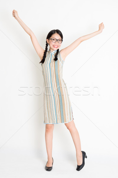 Excited Asian woman arms outstretched Stock photo © szefei