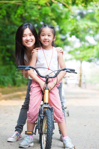 Asian family riding bike Stock photo © szefei