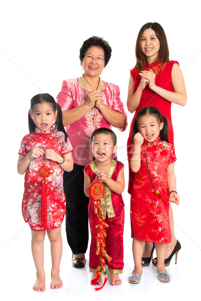 Asian Chinese family greeting on Chinese New Year Stock photo © szefei