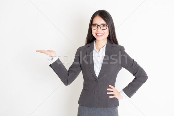 Businesswoman hand holding something Stock photo © szefei