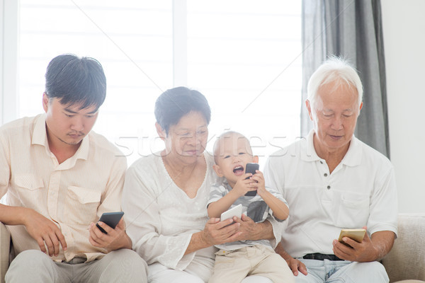 Smartphone addicted family  Stock photo © szefei