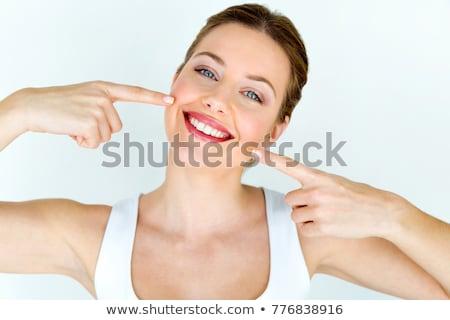 歯科 · 歯 · パーフェクト · 笑顔 · 女性 · ポインティング - ストックフォト © anna_om