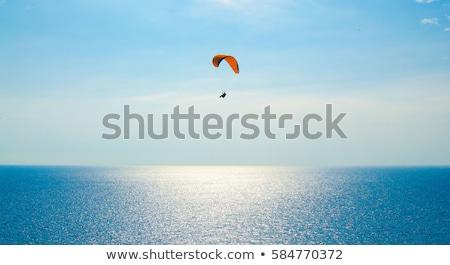 Siklórepülés tengerpart tájkép kék hegyek víz Stock fotó © bbbar