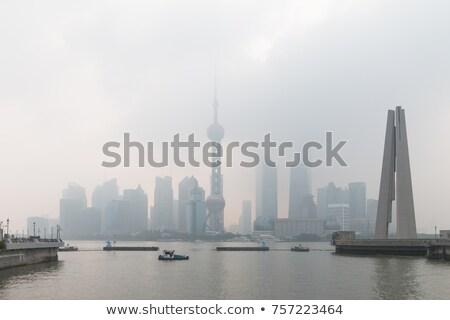 Sjanghai laat namiddag stad rook skyline Stockfoto © craig