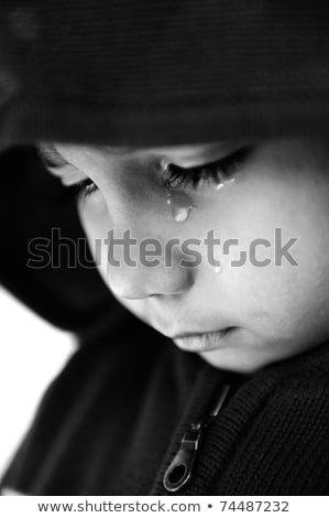 Stock fotó: Kid Crying Focus On His Tear Added A Bit Of Grain Black And White