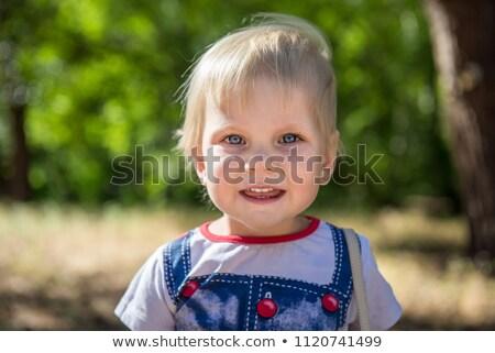Ritratto ragazza parco faccia sfondo Foto d'archivio © dmitrimaruta