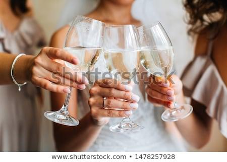 Menyasszony koszorúslány üveg bor kanapé nő Stock fotó © Pilgrimego