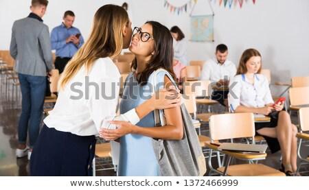 retrato · duas · mulheres · ouvir · escritório · menina · trabalhar - foto stock © HASLOO