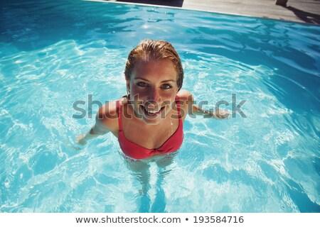 Mooie jonge vrouw Rood bikini water permanente Stockfoto © pkirillov