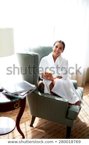 Mulher jovem enrolado cadeira menina sorrir feliz Foto stock © photography33