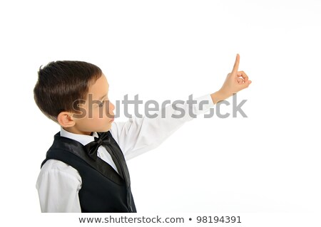 school boy in black suit touching something with his finger isol Stock photo © vkraskouski