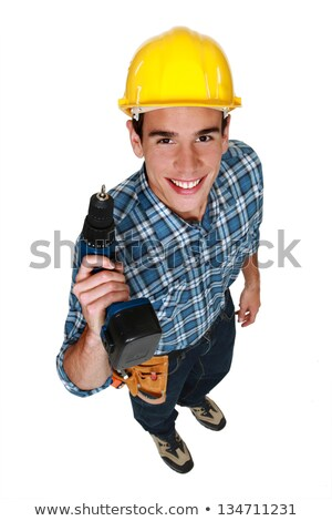 Carpenter stood with cordless drill Stock photo © photography33