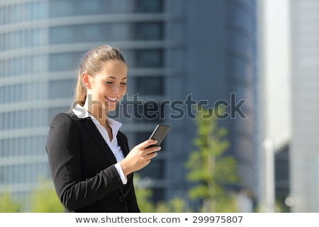 Corporate lady reading sms Stock photo © stockyimages