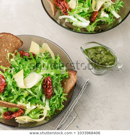 Serving of fresh green salad and bread stock photo © veralub